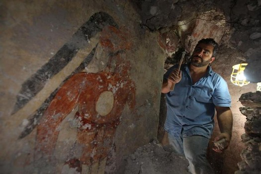 William Saturno, a Boston University archeologist, excavates a mural in a house in Xultun